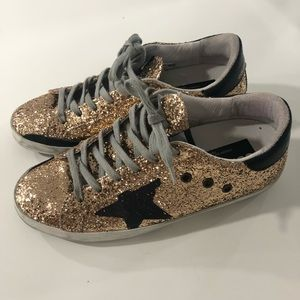 Golden goose sneakers gold and black 38